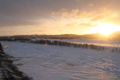 夕日と天塩川